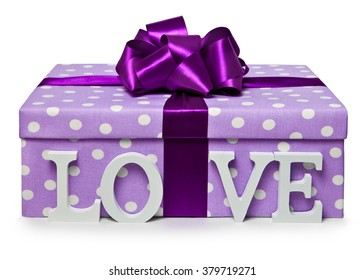 The letters love are near gift boxes with bowknot