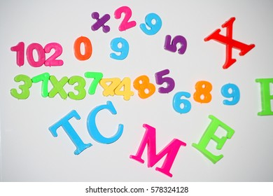 The letters and numbers on the magnets for the initial development of the child