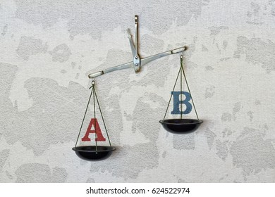 Letters on a balance as a two different possible choices