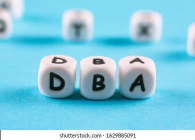 Letters on white plastic blocks DBA (or Doctor of Business Administration)