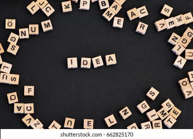 Letters on wooden cubes write the word idea