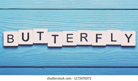 Letters real text with butterfly