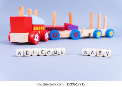 "Letters saying ""Welcome Baby"" in the front, a colorful toy train in the back - newborn concept"