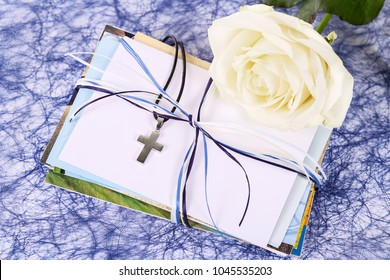 Letters with white rose and necklace with crucifix