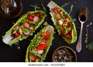 Lettuce leaves with vegetables, cheese, herbs and balsamic vinegar, light and healthy salad