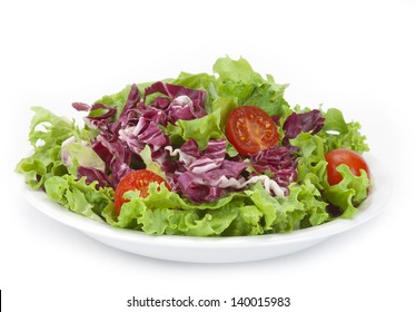 lettuce and red cabbage salad with cherry tomatoes isolated on a white background