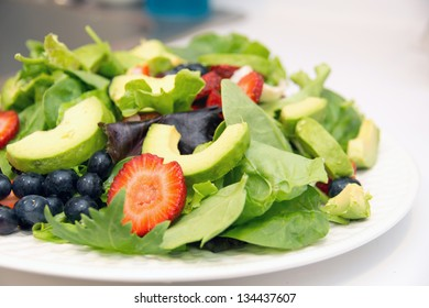 Lettuce salad with avocado and fruits