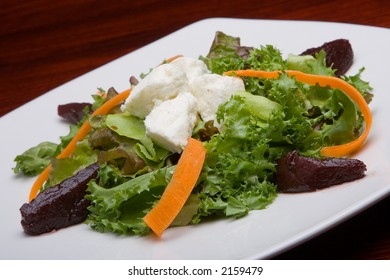 Lettuce salad with cheese, lettuce, beet, carrot