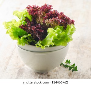 Lettuce salad  on a wooden table