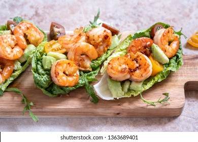 Lettuce wrapped Shrimp tacos with fresh tomato, avocado and lime