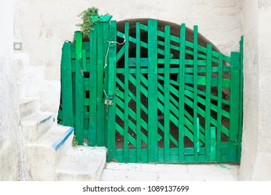 Leuca, Apulia, Italy - An old handmade green folding gate in a fortress