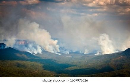 Leura, New South Wales / Australia - January 7th 2019: Erskine Creek Bush Fire in the Blue Mountains. Plumes of smoke rise from multiple fires filling the valley with smoke on its way to Sydney.