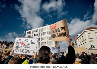 "Leuven, Belgium - February 7, 2019: The ""Youth For Climate"" organization urges Belgian youngsters to march and protest during school hours to raise political awareness for climate change. Slogans."