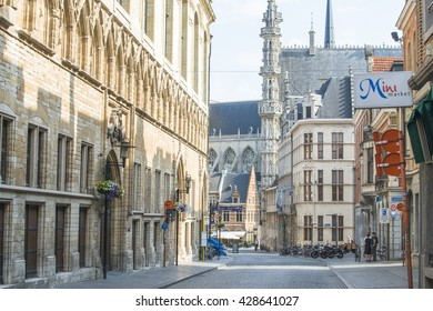 LEUVEN, BELGIUM - JULY 5, 2015: One of the streets of the historic city center, in the background you can see the municipality, Gothic.