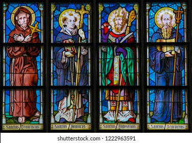 Leuven, Belgium - June 29, 2013: Stained glass in the church of Leuven, Belgium, depicting Saint Francis, Saint Dominic, Saint Augustine and Saint Benedict.