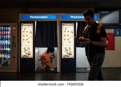 Leuven, Belgium - October 19th, 2017: a person having a picture taken in a Photomaton Photo booth