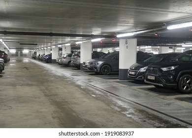 Leuven , Brabant , Belgium 02 16 2021 : Various cars parked  in a large underground parking lot of a clinic