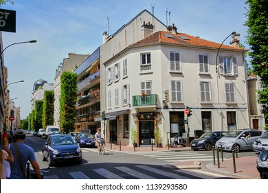 Levallois-Perret, France - June 28, 2015: Intersection of Rue Rivay and Rue Camille Pelletan. Facade of the building with a Japanese restaurant. People and Transport