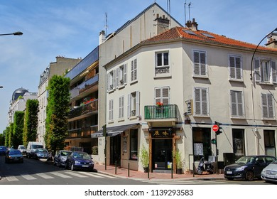 Levallois-Perret, France - June 28, 2015: Intersection of Rue Rivay and Rue Camille Pelletan. Facade of the building with a Japanese restaurant