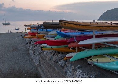 LEVANTO, ITALY - 7 AUGUST 2018: beach with surfing boards at evening