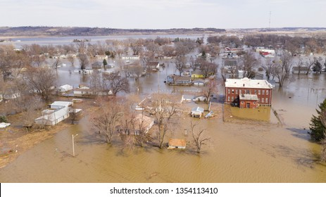 A levee breaks in the midwest flooding the entire town of Pacific Junction and its residents