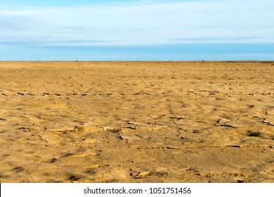 Leveling ground, compacting construction area. Desert Landscape and background. Sand panorama, leveling soil. Beautiful natural desert sand on cloudy sky.