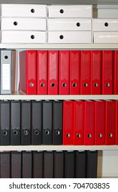 Lever arch file binders at shelf in office archive