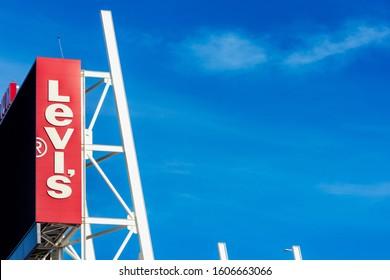 Levi's advertisement sign on Levi's Stadium home of San Francisco 49ers of the National Football League. Blue sky background - Santa Clara, California, USA - January, 2020