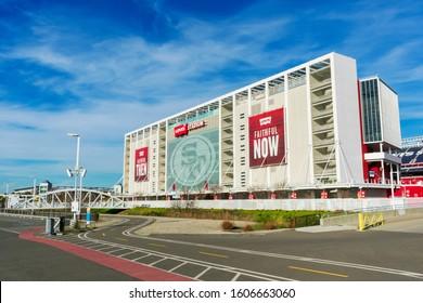 Levi's Stadium exterior home of San Francisco 49ers of National Football League. Full separated bike path, white steel pedestrian bridge spanning San Tomas Creek - Santa Clara, California, USA - 2000