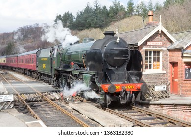LEVISHAM, ENGLAND, APRIL 04 2019 Former Southern Railway 'Schools Class' steam locomotive 926 Repton at Levisham Station on The North Yorkshire Moors Railway, England.