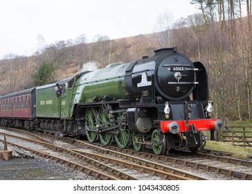 LEVISHAM ENGLAND, MARCH 11, 2018  A1 Pacific steam locomotive 60163 Tornado in  British Railways livery at Levisham Station on The North Yorkshire Moors Railway, Yorkshire, England.