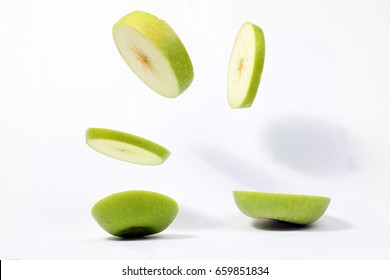 Levitated green apple slices flying air gravity deifying