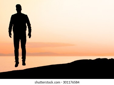 Levitating man in the sunset