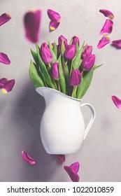 Levitating purple tulips against old concrete background