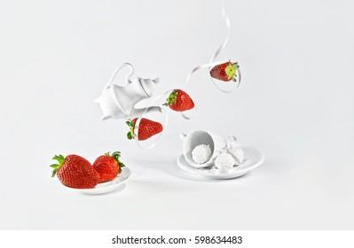 Levitating red strawberries with white ribbon and small decorative dishes on white background.