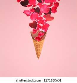Levitating sugar cone with splashes of rose petals and hearts. Surprise, holiday and coffee love concept. Minimal art trend. Solid background. Square