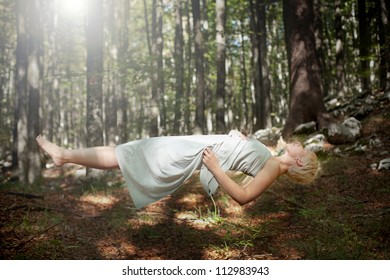 Levitating woman in the forest