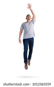 Levitation, funny attractive young Asian man jumping walking on the air