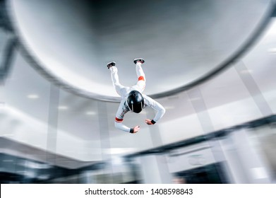 Levitation people. Indoor skydiving. Team flyers. Yoga fly in wind tunnel. Indoor skydiving.