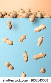 Levitation of unclean peanuts on blue background.