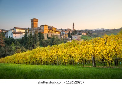 Levizzano Rangone village and Castle with autumnal wineyards. Modena district, Emilia Romagna, Italy