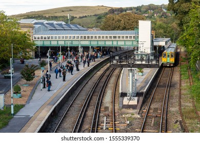 Lewes Brighton, England - October 23, 2019: The front entrance and exit way of Lewes Railway Station, Lewes. Brighton East Sussex, UK. Commuters getting off train on platform of station as seen from a