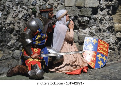 Lewes Castle Sussex England 1995.Two reenactors of the Medieval period dressed as Henry V in full armour and his wife Queen Catherine kneel in prayer in a castle setting.