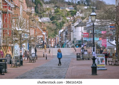 LEWES, EAST SUSSEX, UK - CIRCA FEBRUARY 2016 - A young redhead woman walks along Lewes High Street. The County Town is completely within the South Downs National Park