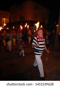 Lewes, East Sussex/England - November 5 2018: People in costume in procession at night with lit torches celebrating Guy Fawkes Bonfire Night