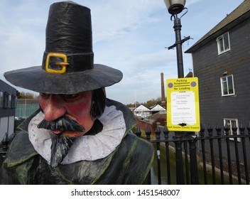 Lewes, East Sussex/England - November 5 2018: Head of effigy of Guy Fawkes in Lewes town centre saying A Penny For the Guy with no parking sign for Bonfire Night event