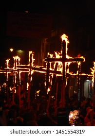 Lewes, East Sussex/England - November 5 2018: Burning crosses at night to symbolise the historic protestant martyrs at the famous Lewes Bonfire Night Guy Fawkes processions