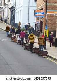Lewes, East Sussex/England - November 5 2018: Members of a bonfire society in Lewes prepare for the night procession by taking metal trolleys to the venue. These will contain burning torches.