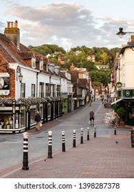 Lewes, England, UK - August 21, 2013: Pedestrians walk past shops and resturants on Cliffe High Street in the East Sussex town of Lewes.