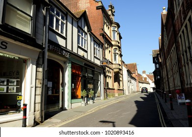 LEWES, ENGLAND-6 SEPTEMBER 2015: Small quiet road and pedestrians through shops and old buildings. There is a black car in distant in Lewes town. It is the county town of East Sussex, England, UK